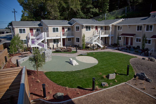 Courtyard garden and playground at the fireside apartments for Courtyard landscape oostburg wi