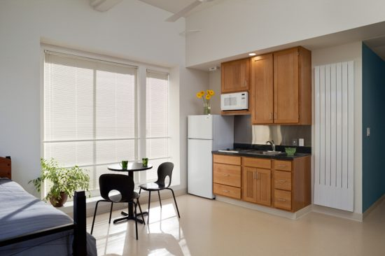 Each studio apartment at Kelly Cullen Community has an accessible or adaptable kitchen and bathroom, low toxic finishes, and plenty of daylight. (Photo by Mark Luthringer)