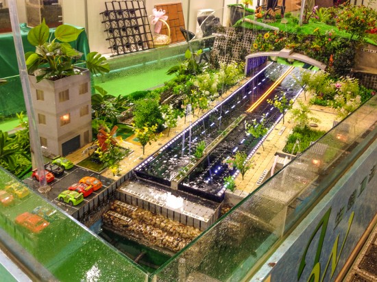 A model of Mr. Jui-Wen Chen's proposal showcases how the JW Pavement can be used for various infrastructure systems: roadways, pedestrian walkways, retaining walls, green roofs, and stormwater retention ponds utilized for raising fish or maintaining agriculture. (Photo by Mignon O'Young)