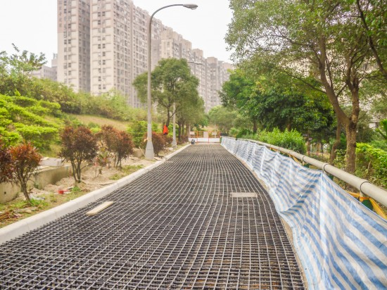 Construction of the pedestrian walkway in New Taipei City, Taiwan: the completed installation of the Aqueduct Assembly structural grid units and gravel for the JW Pavement awaits the concrete pour. (Photo courtesy Ping Tai Co., Ltd.)