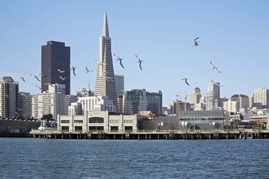 The San Francisco skyline serves as a backdrop for the new Exploratorium located in a historic pier building and designed by EHDD. (Photo by Bruce Damonte)