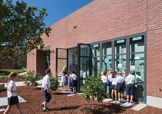 WRNS Studio architects cleverly designed the plumbing room housing the rainwater harvesting and greywater systems to serve as a visual and accessible classroom at the Stevens Library at Sacred Heart Schools. (Photo by Bruce Damonte)