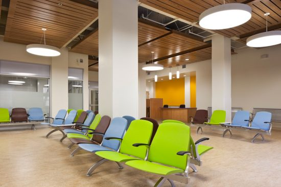 The reception lobby at the LEED CI Gold-certified Tom Waddell Urban Health Clinic in San Francisco is a modern and space-conscious room accented with cheerful colors. (Photo by Mark Luthringer)