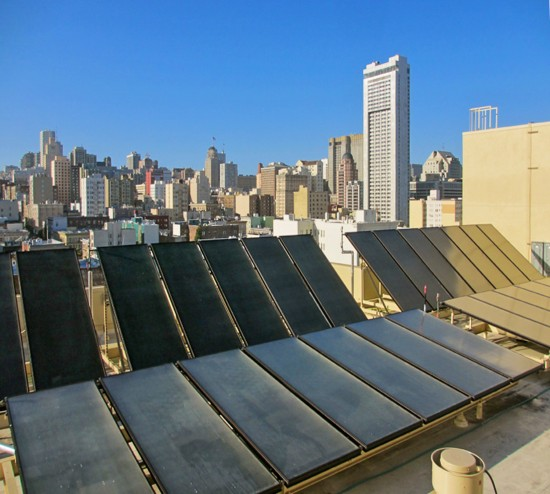 The solar thermal system on the rooftop of the Kelly Cullen Community in San Francisco pre-heats the building's hot water system and helps minimize the use and operation cost of gas. (Photo courtesy Gelfand Partners Architects)