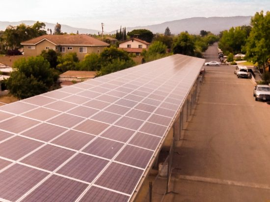 The 182 kW solar photovoltaic system sits atop the carports at Clarendon Street Apartments in San Jose, California. (Photo courtesy Arbor Building Group, Inc.)