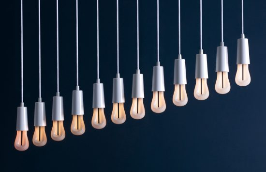 A row of Plumen 002 LED bulbs showing the range of dimmability. (Photo courtesy Plumen)