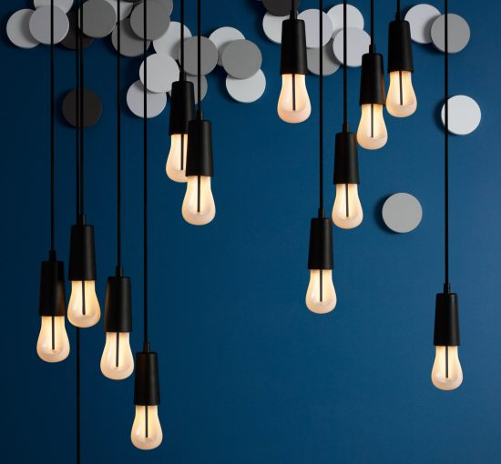 A cluster of Plumen 002 LED bulbs make for a fun, energy efficient, and sculptural lighting display. (Photo courtesy Plumen)