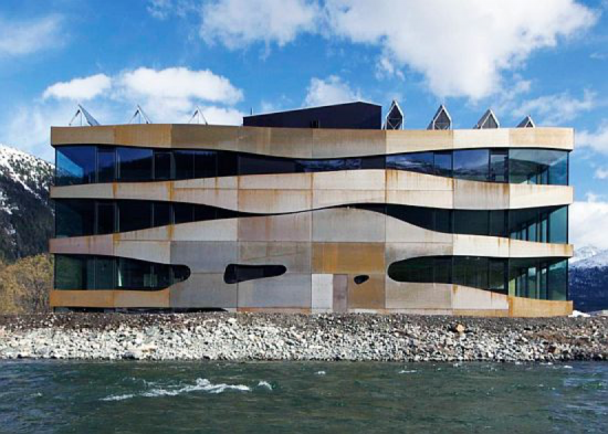Building design can be planned with solar energy in mind: Commercial Building Islas by Mierta & Kurt Lazzarini Architekten. Source: http://www.ecochunk.com/2573/2012/09/20/office-building-in-switzerland-works-like-a-battery-storing-renewable-energy/
